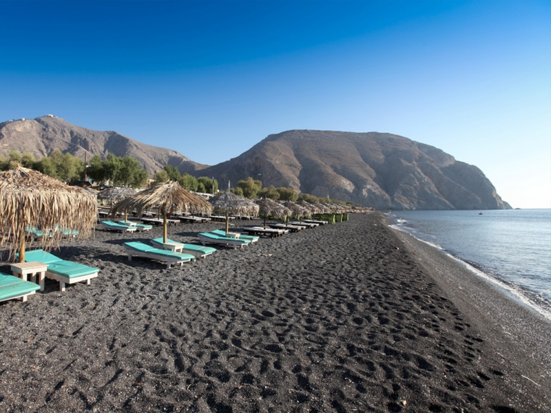 a huge beach with black pebbles and everything you need to be organized.